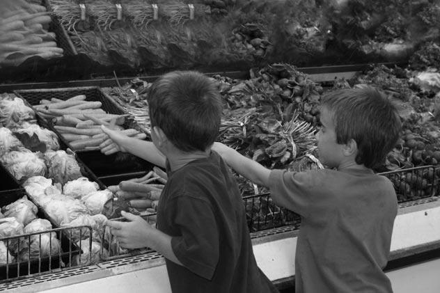 Children in produce section of supermarket